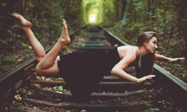 Girl Levitation Portrait Photograph on Railway Track